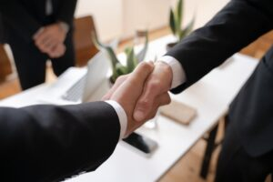 Lawyers Shaking Hands Over Commercial Lease Negotiation Facilitated by Sarnia Law GMSB